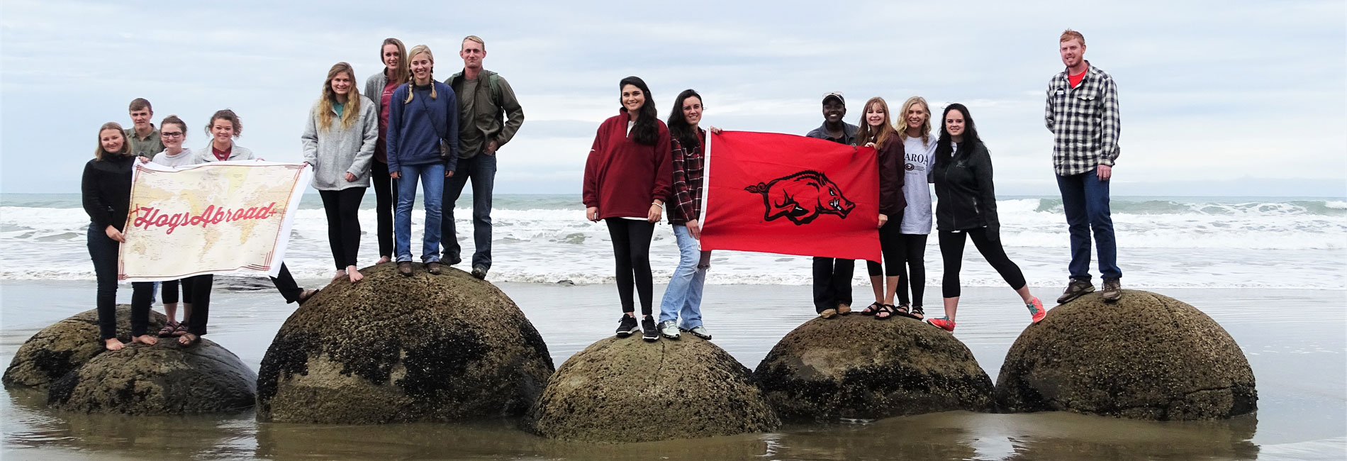Students posing on the beach in New Zealand