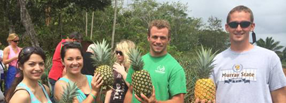 Students posing on pineapple farm